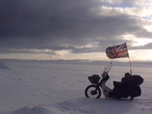 Riding a Honda C90 motorcycle through the Arctic Circle in Winter