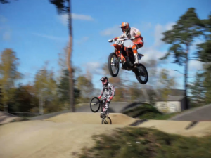 Gundars Osis (bmx cruiser) vs Matiss Karro (mx bike) on a BMX track