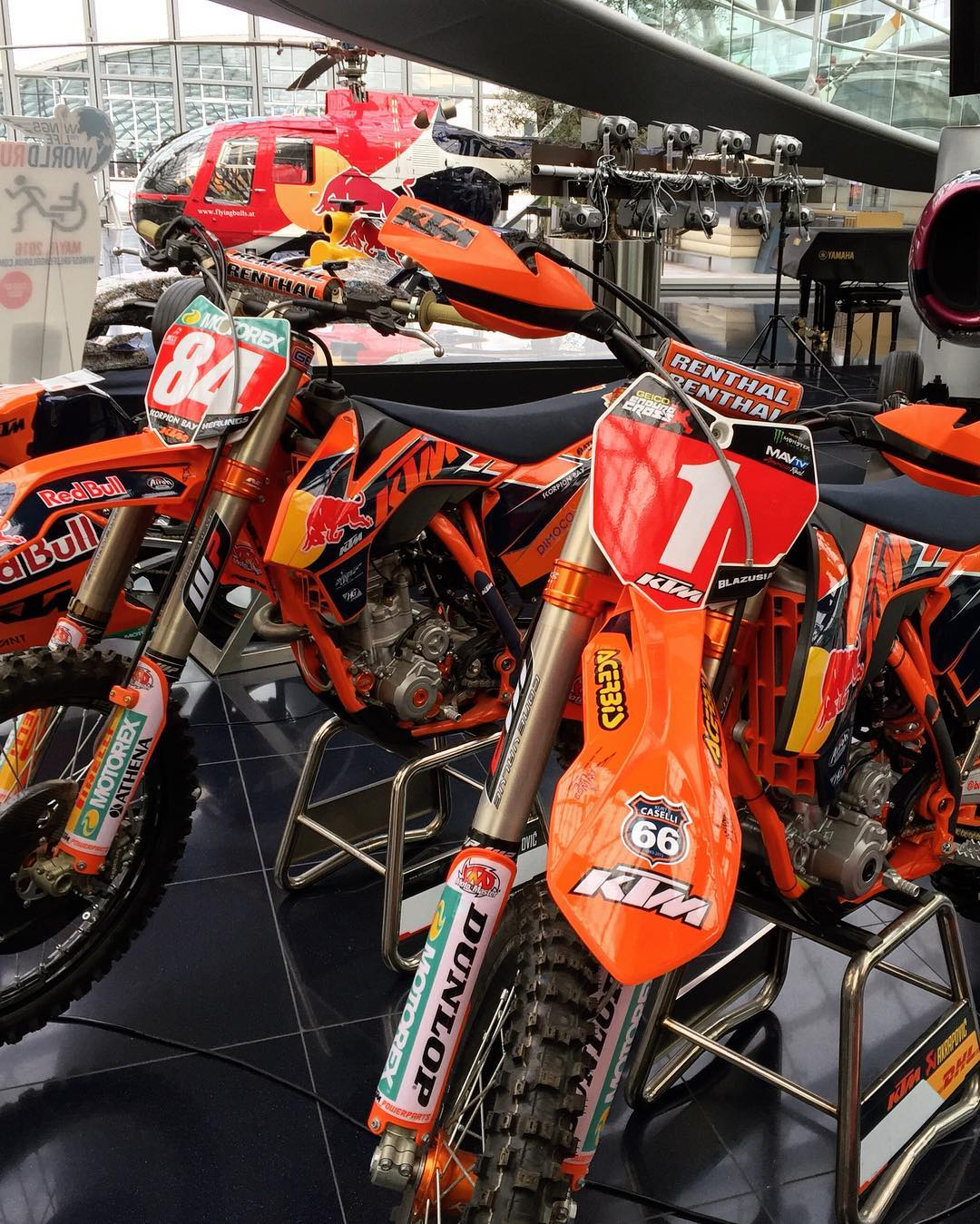 Quick trip to Red Bull's Hangar 7 today. Cool to see these 2 championship winning bikes there which I was lucky enough to get to do the graphic design for. chrome highlights and orange to red gradients to symbolise them winning so much at that time!  #KTM #de_portfolio