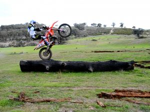 Tim Coleman having fun on Logs