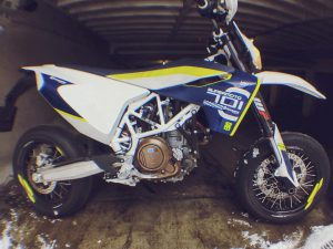 The #701 waiting impatiently for the snow to melt so it can come out and play! #husqvarna #supermoto