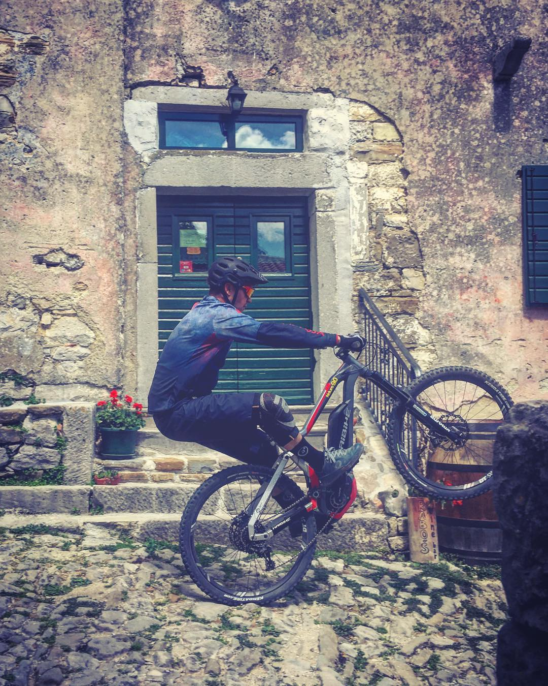 Manual down the 900 year old streets of Hum, Croatia #wheeliewednesday #emtb #biking