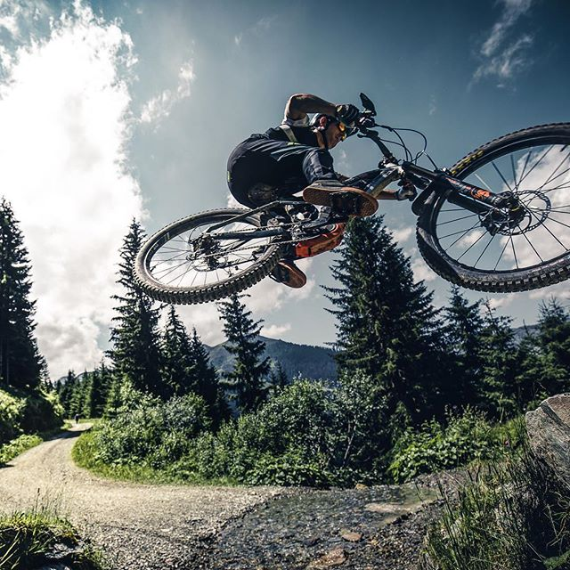 Sending the Saalbach River gap. 📷 by @sampilgrim #ride100percent #haibike #weareeperformance #emtb